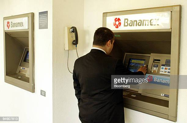 A bank customer uses an automated teller machine at a Banamex branch bank in Mexico City on Thursday January 29 2004 Banamex Mexico's secondbiggest...