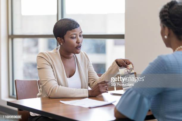 Bank employee talks with potential customer