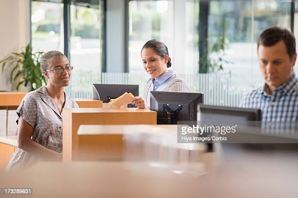 Bank employees at counter