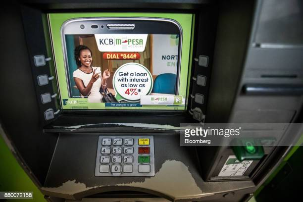 Bank Kenya Ltd automated teller machine displays MPesa banking service information outside a bank branch in Mombasa Kenya on Thursday Nov 23 2017 The...