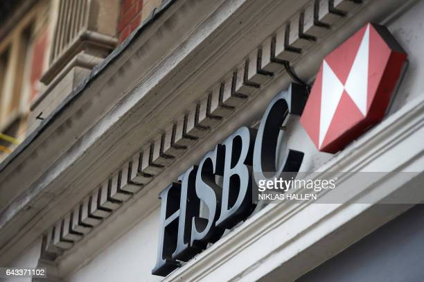 A HSBC bank logo is seen outside a branch of the bank in central London on February 21 2017 HSBC profits plunged last year on huge writedowns and...