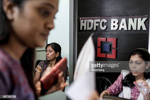 Bank Ltd employees work at one of the company's bank branches in Mumbai India on Friday Feb 1 2013 HDFC Bank India's secondlargest lender by market...