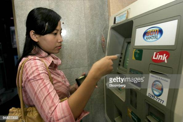 A Bank Mandiri Customer Uses An Atm In Jakarta Indonesia May 27 News Photo Getty Images