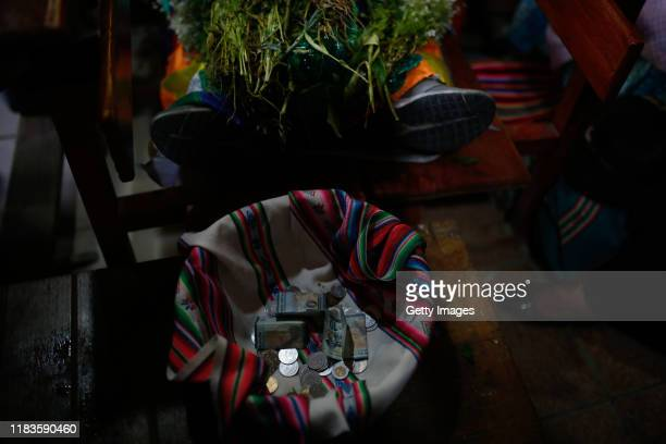 Bank notes and coins in a basket are given as offerings to Pachamama also known as 'earth mother' during the funeral of people killed yesterday...