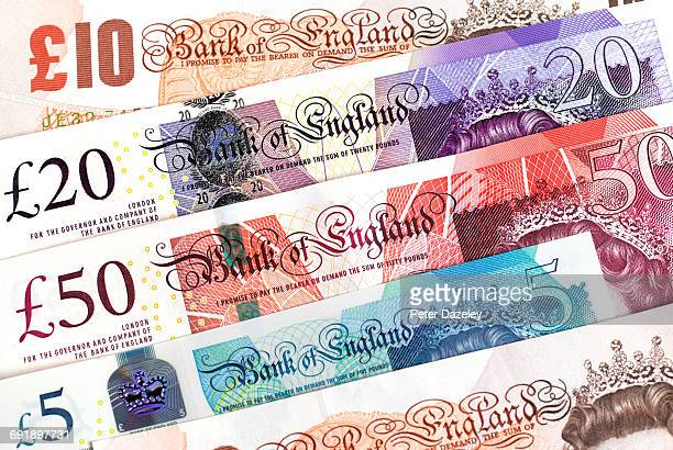 uk bank notes close up - pound sterling note stock photos and pictures