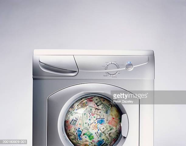 Bank notes spinning in washing machine (Digital Composite)