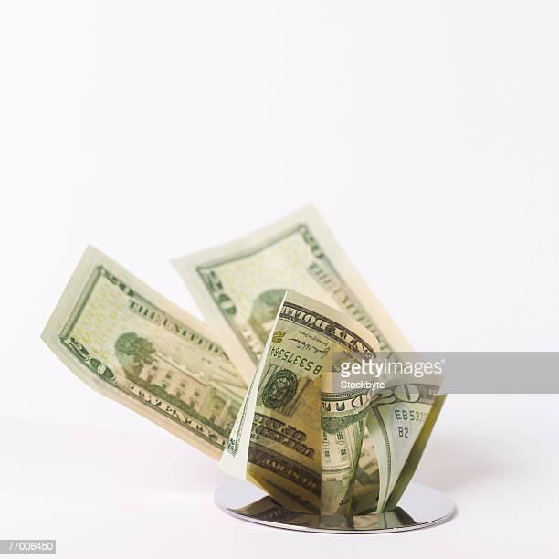 Bank notes stuffed down drain