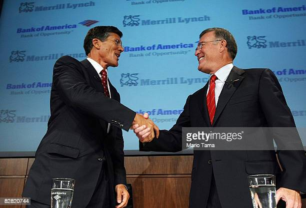 Bank of America CEO Ken Lewis and Merrill Lynch CEO John Thain shake hands at a press conference at Bank of America headquarters September 15 2008 in...