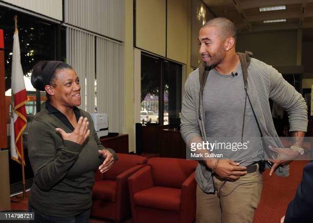 Bank of America customer Elna Kennedy and Los Angeles Dodger Matt Kemp makes a surprise visit to the Bank Of America Hollywood location on May 26...