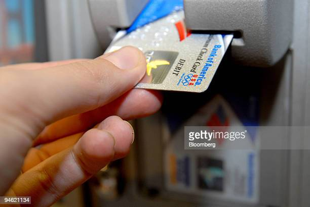 Bank of America customer uses a bank card to make a transaction at branch office in New York Thursday October 19 2006 Citigroup Inc and Bank of...