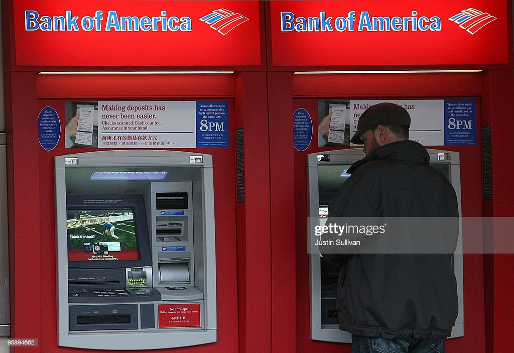A Bank of America customer uses an ATM at a Bank of America branch office January 20, 2010 in San Francisco, California. Bank of America reported a fourth quarter loss of $5.2 billion or 60 cents a share compared to $2.4 billion or 48 cents one year ago.
