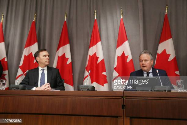 Bank of Canada Governor Stephen Poloz and Finance Minister Bill Morneau speak during a news conference on Parliament Hill March 18, 2020 in Ottawa,...