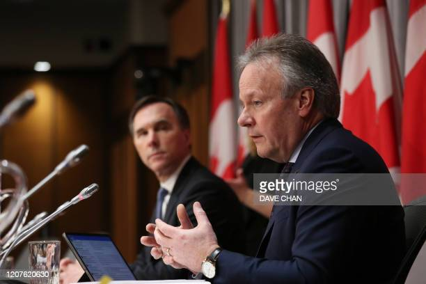 Bank of Canada Governor Stephen Poloz and Finance Minister Bill Morneau speaksduring a news conference on Parliament Hill March 18 2020 in Ottawa...