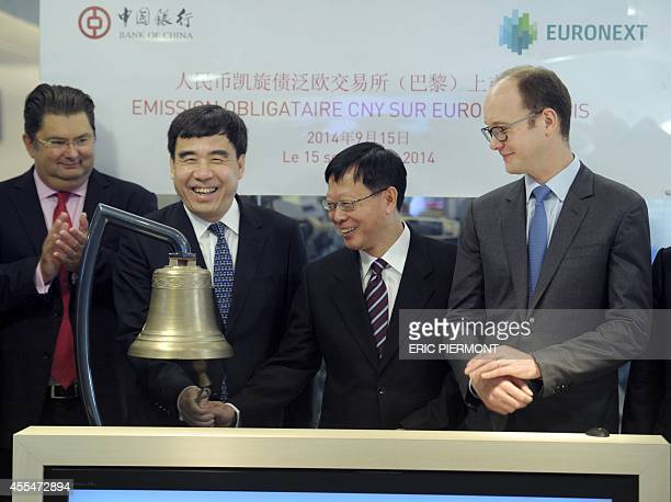 Bank Of China Chairman Tian Guoli is flanked by China Investment Corporation's Chairman Ding XueDong Euronext France CEO Anthony Attia and Euronext...