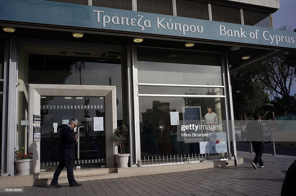 A Bank of Cyprus branch is seen as the country's banks re-open following 12 days of closure on March 28, 2013 in Nicosia, Cyprus. Bank trading began again after the government negotiated a EUR 10bn (GBP 8.4bn) bailout package. Captial controls are limiting withdrawals to EUR 300 perday and the Cyprus stock exchange remains closed.