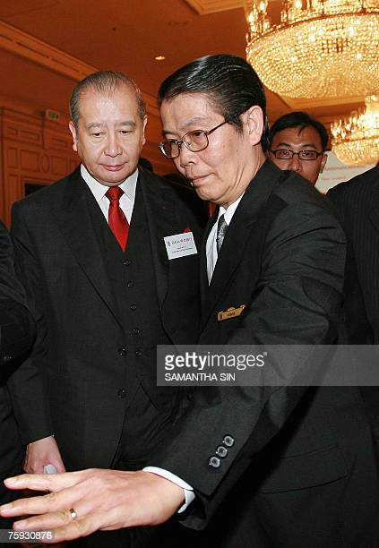 Bank of East Asia chairman David Li leaves a press conference on the interim result of the bank in Hong Kong, 02 August 2007. The third-largest bank,...