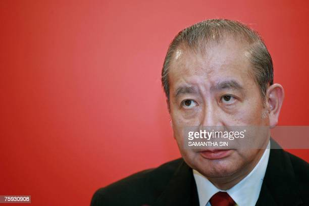 Bank of East Asia chairman David Li looks on during a press conference on the interim result of the bank in Hong Kong, 02 August 2007. The...