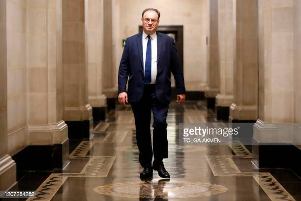 Bank of England Governor Andrew Bailey poses for a photograph on the first day of his new role at the central bank in London on March 16 2020