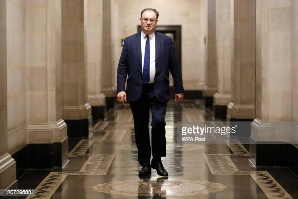 Bank of England Governor Andrew Bailey poses for a photograph on the first day of his new role at the central bank on March 16 2020 in London England