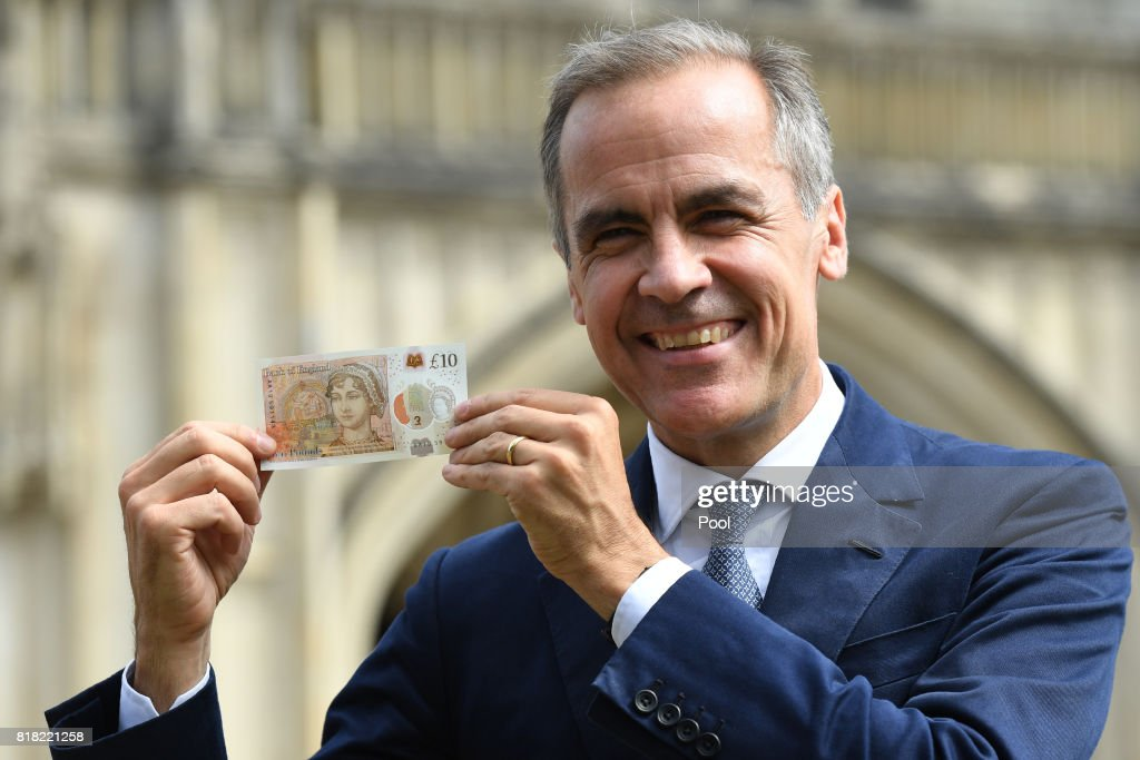 Bank of England Governor Mark Carney poses with one of the central bank's new ten pound notes, featuring British author Jane Austen, during its unveiling at Winchester Cathedral on July 18, 2017 in Winchester, England. Two hundred years after Jane Austen's death, Britain is celebrating one of its best-loved authors, who combined romance with biting social commentary that still speaks to fans around the world. Austen is buried in the cathedral in Winchester, where she died.