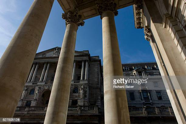 Bank of England seen through rising pillars and columns of Cornhill Exchange City of London We look upwards to the famous Bank of England in the City...