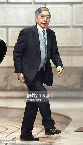 Bank of Japan Governor Haruhiko Kuroda arrives at the central bank's head office in Tokyo on Dec. 20, 2016. The BOJ will conclude its two-day policy...