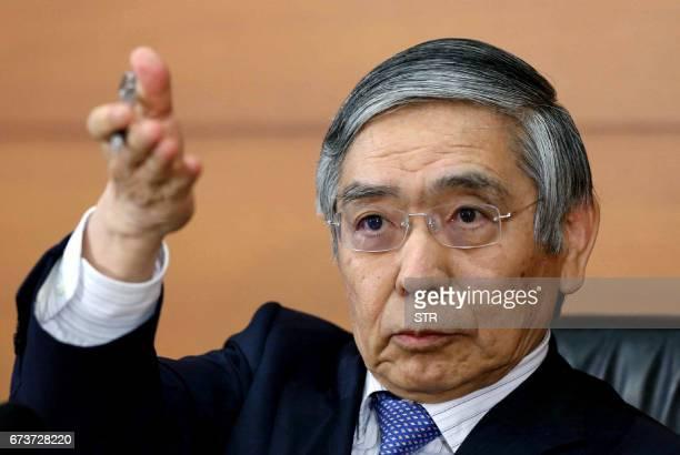 Bank of Japan governor Haruhiko Kuroda attends a press conference at the BOJ headquarters in Tokyo on April 27, 2017. - Kuroda warned on April 27 it...