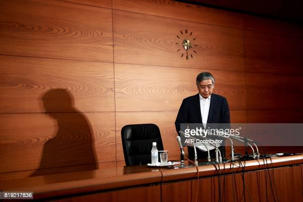 Bank of Japan governor Haruhiko Kuroda attends a press conference in Tokyo on July 20 2017 The Bank of Japan slashed its annual inflation forecast...