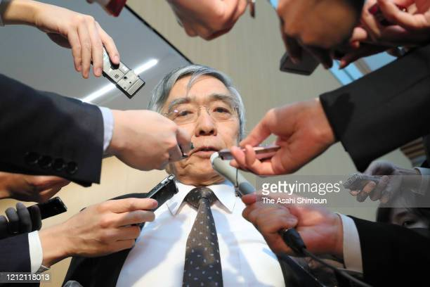 Bank of Japan Governor Haruhiko Kuroda is surrounded by media reporters after his meeting with Japanese Prime Minister Shinzo Abe after the World...