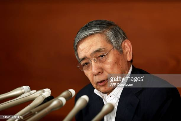 Bank of Japan governor Haruhiko Kuroda listens to a question during a press conference in Tokyo on July 20 2017 The Bank of Japan slashed its annual...