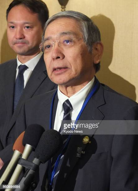 Bank of Japan Governor Haruhiko Kuroda speaks to reporters in Washington on Oct 12 before a twoday Group of 20 financial meeting starts later in the...