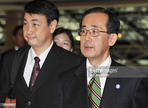 Bank of Japan Governor Masaaki Shirakawa leaves a media briefing at a hotel before the G20 Finance Ministers and Central Bank Governors meeting in...
