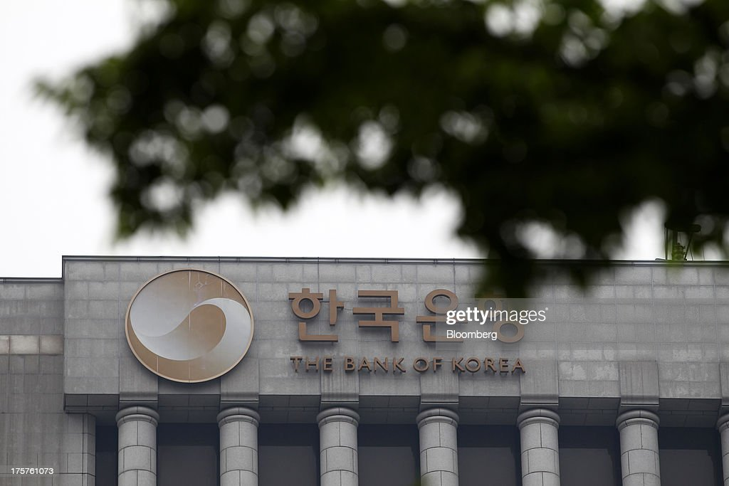 Bank of Korea signage is displayed atop the central bank's headquarters in Seoul, South Korea, on Thursday, Aug. 8, 2013. The Bank of Korea held its benchmark interest rate steady, as signs of stronger growth in the U.S. back its view that the economy will gather momentum. Photographer: SeongJoon Cho/Bloomberg via Getty Images
