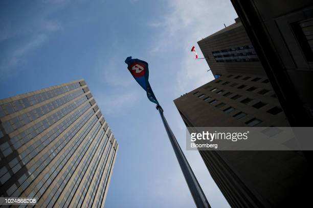 A Bank of Montreal flag flies outside the company's headquarters in Montreal Quebec Canada on Monday Aug 20 2018 Median singlefamily home prices in...