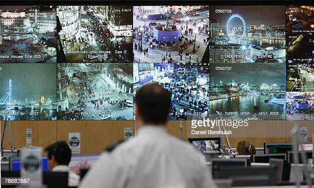 Bank of television monitors displays images captured by a fraction of London's CCTV camera network within the Metropolitan Police's Special...