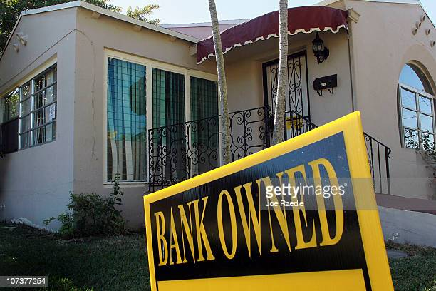 A bank owned sign is seen in front of a foreclosed home on December 7 2010 in Miami Florida Foreclosure sales made up 397 percent of home sales in...
