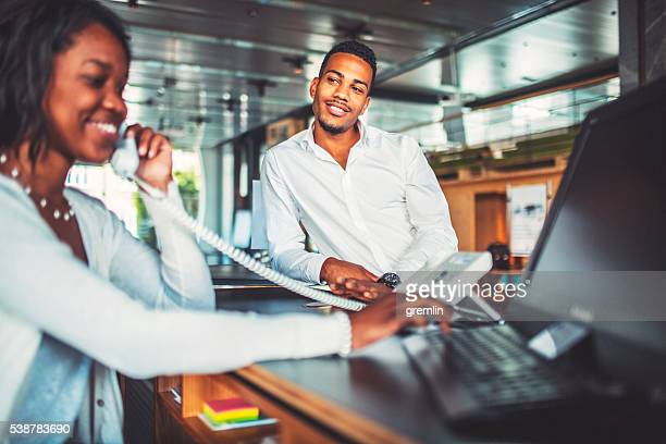 bank receptionist helping customer, businessman - work romance stock pictures, royalty-free photos & images