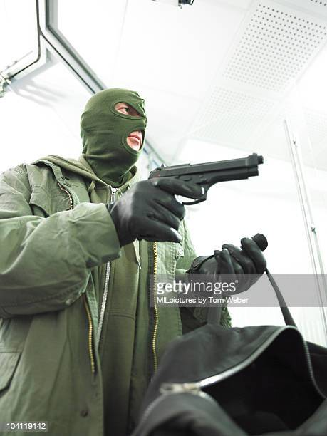 Bank robber with hand gun.