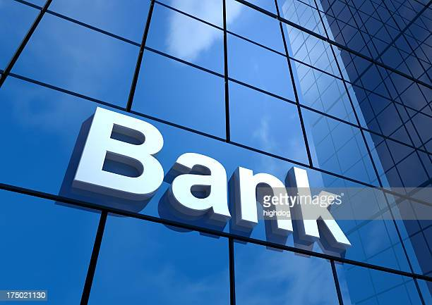Bank sign on a wall of windows