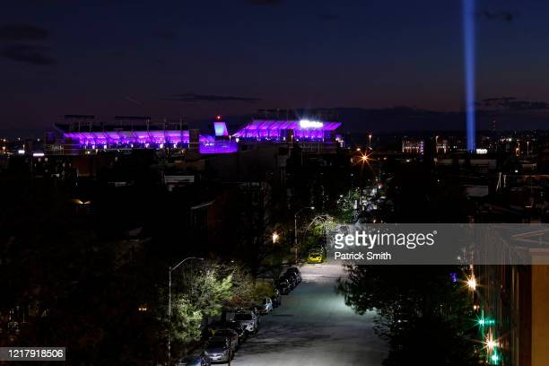 Bank Stadium home of the Baltimore Ravens NFL team is illuminated on April 09 2020 in Baltimore Maryland Landmarks and buildings across the nation...