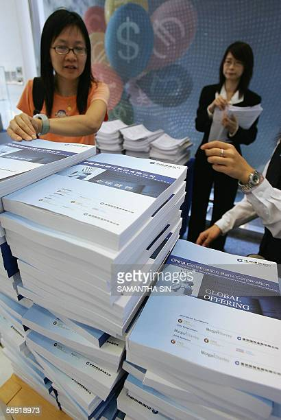 Bank staff distribute copies of the prospectus for the Initial Public Offering of China Construction Bank in Hong Kong 14 October 2005 The CCB is the...