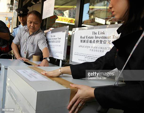 Bank staff seal the collection box for The Link Real Estate Investment Trust during the last day of the retail portion of the IPO in Hong Kong on 17...