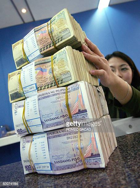 A Bank Teller Prepares Stacks Of Philippine Peso 28 January 2005 The Local Currency Has Rebounded