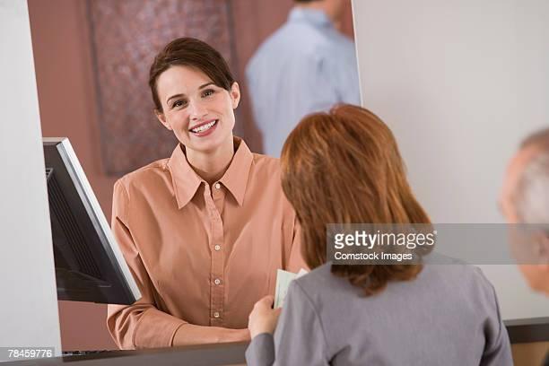 Bank teller waiting on customer