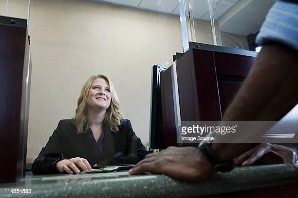 Bank teller working in bank