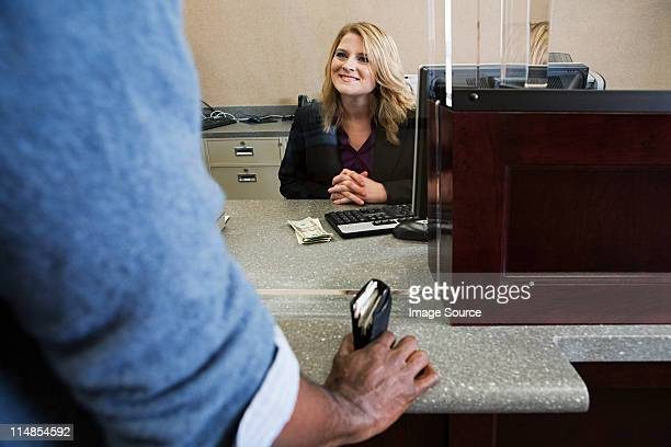 bank teller working in bank - cashier stock pictures, royalty-free photos & images