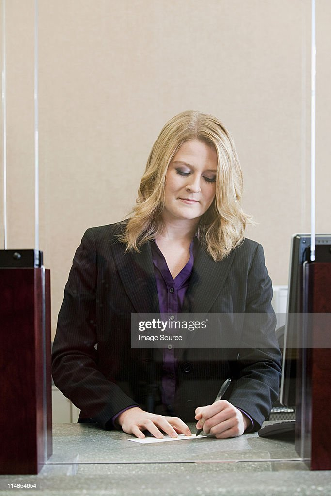 Bank Teller Working In Bank Stock Photo Getty Images