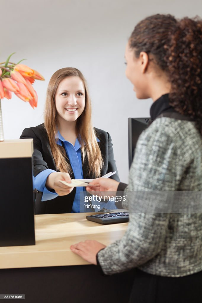 Bank Teller Working with Customer at Retail Bank : Stock Photo