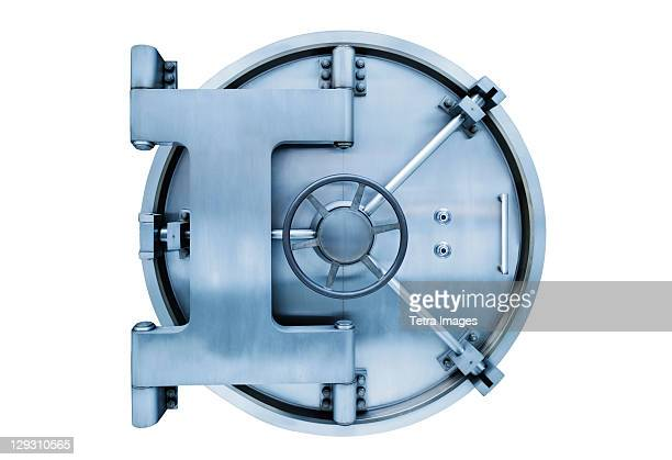 Bank vault door on white background