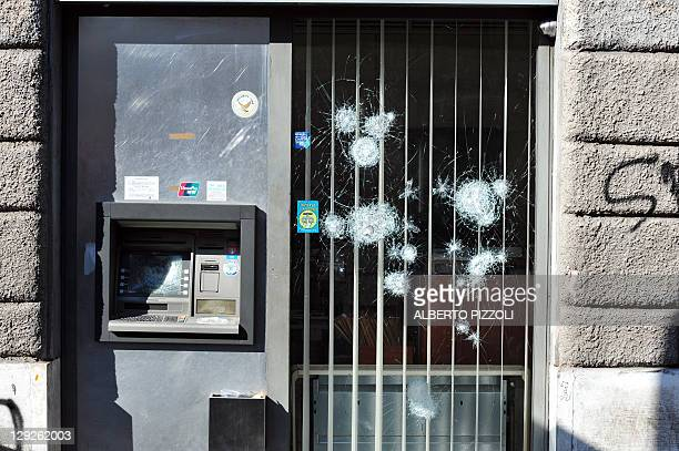 Bank with damaged door and ATM is seen during a demonstration, in dowtown Rome on October 15, 2011. Tens of thousands marched in Rome today as part...
